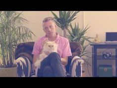 Macklemore of Macklemore & Ryan Lewis demonstrates how to hold a cat for Cracker Jack'D (for some reason). #cats #advertising #marketing