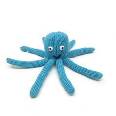 """The Octopus rattle is part of Estella's Beach Bum collection or organic baby toys! It is a bright aqua color and its quirky smile and eight legs will keep baby grabbing!  It is hand-knit in Peru from 100% cotton and is GOTS certified organic.  Measures: Approximately 6 x 3"""""""