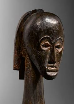 FANG ANGOKH NLO BYERI  RELIQUARY FIGURE  Gabon  Wood  H.: 23,5 cm (total height: 33 cm)