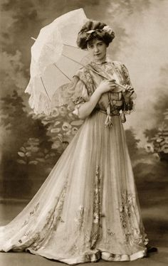 ~1903 photo of a lady wearing a beautiful gown of the era~