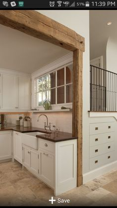 I love this kitchen and sink and especially the inside window.