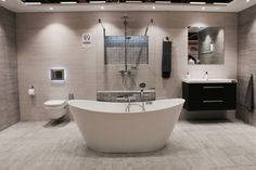 Megaflis Boligmesse 2015 Modern bathroom, freestanding bathtub, Cemento Cassero tile, shower