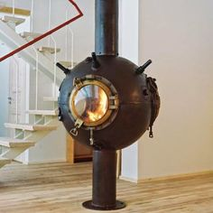Fireplace made from a decommissioned naval mine.