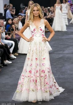 Supermodel Bridget Malcolm walked the runway in a gown delicately embroidered with flowers...