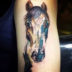 Such a beautiful watercolor horse tattoo by @zoeshorses!