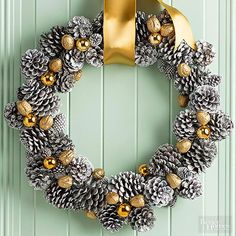 Turn pinecones silver and stud them with gold embellishments for a metallic take on your Christmas door. Start with a basic pinecone wreath and spray-paint it silver. Wire on gold accessories, such as golden nuts (you can spray-paint them yourself if you can't find prepainted) and gold ball ornaments. Hang with a thick silk gold ribbon.