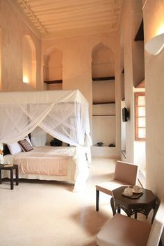Netting over bed. High ceilings. To die for.
