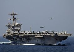 The Nimitz-class aircraft carrier USS Carl Vinson (CVN 70) transits the Strait of Hormuz.