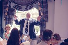 Father of the bride calls for silence during Balmer Lawn Hotel Wedding speeches. Photography by one thousand words wedding photographers