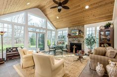 Beautiful sunroom perfect for all seasons! Love the vaulted ceilings with wood accents and stone fireplace. 13360 Calhoun Court, Pickerington, OH.