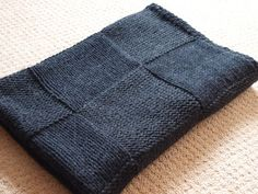 Knitted afghan-seed stitch edges, squares of knit or purl.