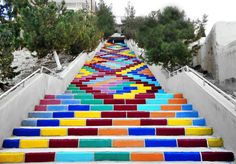 A public staircase in Deir Atieh, Syria is transformed into public art with the help of some paint and young volunteers.