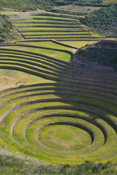 Moray, #Cusco, #Peru. one of the most amazing places in the world. Made by the Inca empire over 600 years ago. Notice the size of the people in the picture to have a better idea of the size of this beautiful site.