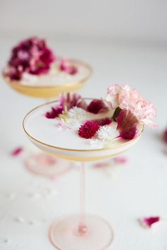 Bachelor's Button Martini | 2 oz gin, 1 ½ oz Lillet Blanc, ¼ oz bachelor's button simple syrup (recipe), 1 oz lemon juice, 1 egg white, bachelor's button and carnation petals, for garnish To make the syrup, combine 1 ½ cups sugar, 1 cup water, ¼ cup bachelor's button petals in a small saucepan and bring to a boil over medium heat, stirring occasionally. Simmer until sugar has dissolved, then lower heat. Cook another 10-15 minutes to allow petals to steep; let cool and strain. After the syrup…