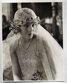 "1925: Vilma Banky in her first U.S. film, ""Dark Angel"" wearing a wedding ensemble."