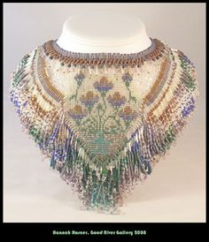 One of my first large-scale beaded collars.  Uses techniques from Virginia Blakelock and a nedlepoint design by Kaffe Fassett.