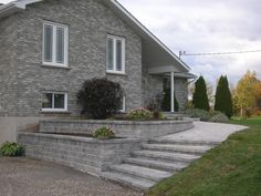 Love this retaining wall idea for my driveway looking to for Walkout basement retaining walls