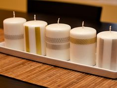 Make a plain white candle look elegant by using washi tape that Blue Sky Design has. Makes great Christmas gift.  #washitape #Christmas #candles