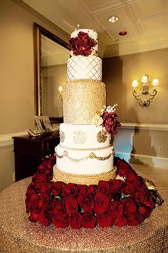 Beautiful and romantic 5-tier Gold and Wine wedding cake!  Hand painted quilting and gold sequin tier.  Cake by Lilly Magilly's!