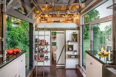 """small-homes: """"Living, sleeping, eating and bathing area in this 240 sq. tiny house which sits on a custom double-axel trailer. Called The Alpha Tiny House, it's designed by New Frontier Tiny Homes. Modern Tiny House, Tiny House Living, Tiny House Design, Small Living, Living Room, Tiny House Luxury, Tiny House Bedroom, Tiny House Loft, Tiny House Builders"""