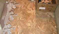 http://www.toysblog.it/post/47499/il-puzzle-di-legno-sul-pavimento-ispirato-a-escher