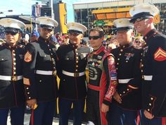 @TeamHendrick drivers @DaleJr, @JimmieJohnson & @JeffGordonWeb stop for a picture with the @USMC! #NASCARsalutes -KC  (Twitter: Miss Sprint Cup @MissSprintCup)