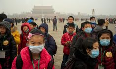 Children wear masks as a thick haze of air pollution envelopes Tiananmen Square in January. Photograph: Alamy