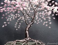 Cherry Blossom Beaded Bonsai~  Height: 7.5 Width: 8 Lead time: 2-6 weeks (all approximate)  This listing is for a custom/ made to order tree. The exact tree in the picture is sold. Another similar, yet still original, tree will be made for you if you purchase this. Please allow 2-6 weeks for me to make your tree or contact me first to see if theres a possibility for a rush order.  Hand beaded wire tree branches are twisted together to create a beautiful, spring-time-all-year, beaded bonsai…