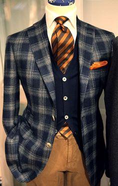 Pumpkin brown striped tie. Tan plaid navy blue jacket blazer.