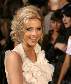 Julianne Hough is adopted a prom Updo hairstyle now a days. She wears the Up do hairstyle but this hair style unfortunately, done this way too old fashioned. A strand of her hair had been pulled out of the ponytail and wound around the hair band and some hair accessories, hiding it.                                                                                                                                                                                 More