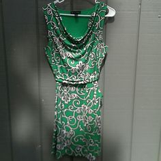 INC dress NWOT emerald green with drapey neck line. Tie around waistline. Very pretty retro style. Easy care fabric-- machine wash, doesn't wrinkle! INC International Concepts Dresses