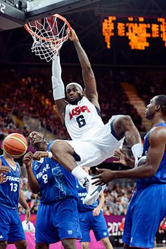 Throw it down                                                                                                                                  		Team USA forward LeBron James dunks over France center Ali Traore (8) during Sunday's men's basketball preliminary game.