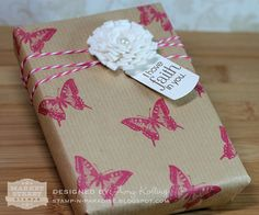 brown paper wrapping .... stamped butterfly ... gorgeous handmade flower with tag ...