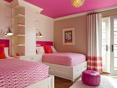 Love the hot pink ceiling in contrast with the stark white moulding, beds and shelving.