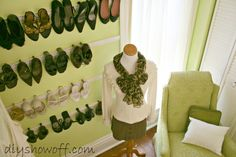 Dressing room makeover at the DIY Show Off blog {trim/molding shoe rack, nail polish storage, shelves, hanging boots, scarves, folding/dressing screen from old bifold doors, etc.}
