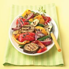 Grilled vegetable salad is perfect for any backyard get-together. Arrange vegetables such as zucchini, peppers, onions and eggplant on a platter and serve them for a crowd.