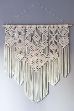 A beautiful bohemian inspired handmade macrame wall hanging. Use this decorative wall hanging to add a handmade touch to your home, office or cabin. I first started experimenting with making macrame wall hangings last year, when I made a few wall hangings for myself and friends. I love