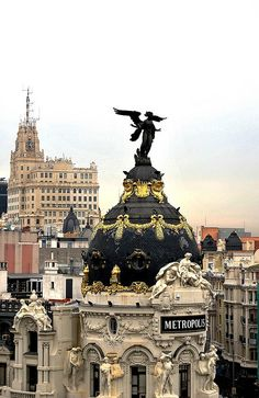 Angel on top of Metropolis Building, Madrid, Spain. Places Around The World, Oh The Places You'll Go, Travel Around The World, Places To Travel, Places To Visit, Around The Worlds, Famous Castles, Spain And Portugal, Spain Travel