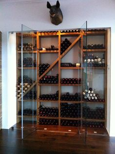 Zebrawood wine cellar with frameless glass and wine cellar refrigeration by Kessick