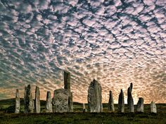 This photo of Calanais Stone Circle, Isle of Skye, Scotland, UK, is made more unreal by that unusual cloud cover. I've seen this type of cloud formation in Colorado with the coming of a cold front. I've never been here, but after visiting Stonehenge, much further south   in England, I am convinced that there are other powers that we know nothing about.
