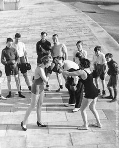 Two female members of a keep fit group learn boxing techniques as part of self…