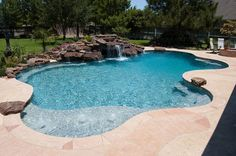 Free form pool, natural waterfall. Swimming Pool Galleries - Cypress Custom Pools