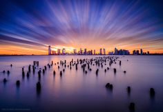 Long exposure photo in New York city. Luckily, this day condition was perfect to take sunset photography. Since strong wind was there and it flowed many clouds quickly. I used ND filter to capture this dynamic long exposure photo.