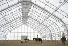 lots of natural light is let in: 100' Wide PRESTIGE straight wall/peaked style Indoor Riding Arena! CHOOSE your length!
