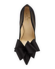 """kate spade new york satin pump. Mesh collar with piped suede trim. 4"""" covered heel. Pointed toe; single sole. Tonal satin bow detail. Leather footbed and sole. """"lovely"""" is made in Italy."""