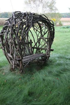 Rustic vine covered garden bench.
