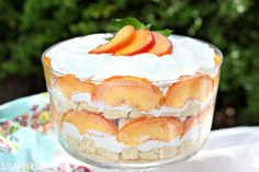 Peaches and cream trifle is an easy summer dessert that's gorgeous and delicious! Pound cake, fresh peaches, and whipped cream are all you need to make it!