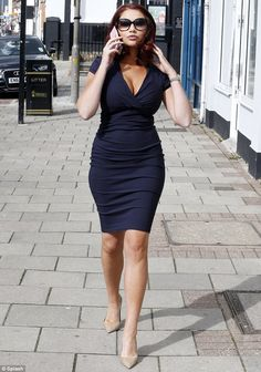 Woman in blue: Amy Childs steps out in Essex on Saturday after paying a visit to her boutique