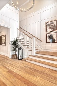 Detailed finish carpentry consists of wainscoting along the walls as well as floor boards and crown molding in this entryway.