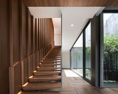 openbox architects has joined architecture and landscape as one, in its most recent residential design in bangkok, thailand.
